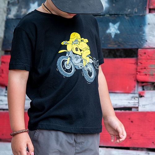 child wearing black Suzuki t-shirt