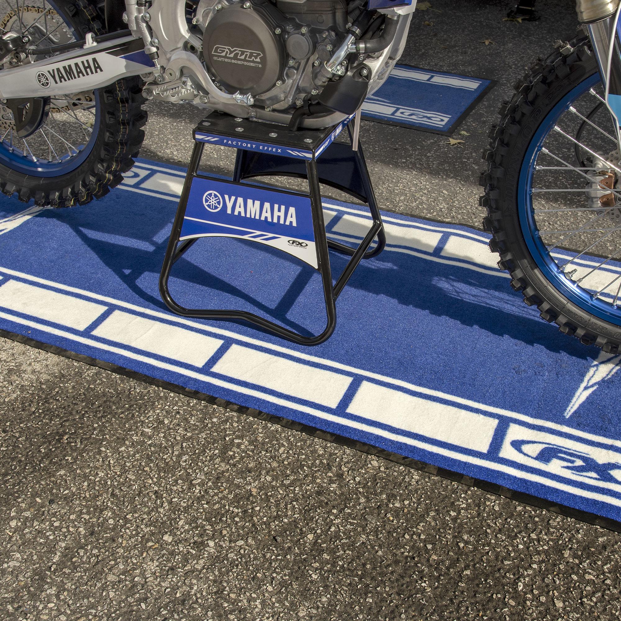 Yamaha bike mat with bike sitting on stand